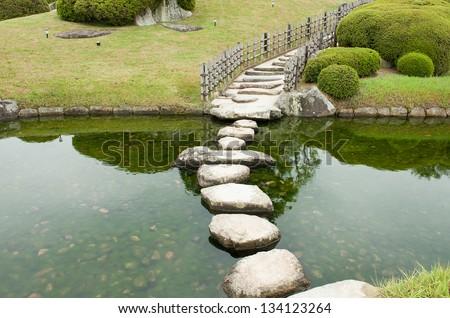 Zen stone path in a Japanese Garden - stock photo