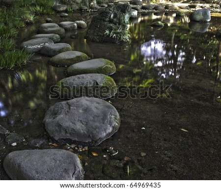 Zen stone path in a Japanese Garden Korakuen. Koishikawa Korakuen is one of oldest Japanese gardens in Tokyo. Japan, HDR - stock photo