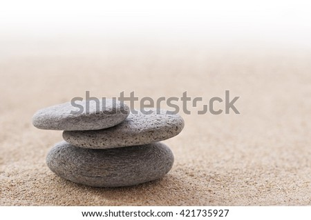 Zen stone stack and sand