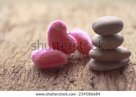 Zen stones and violet Heart on a wooden background, Love vintage concept - stock photo