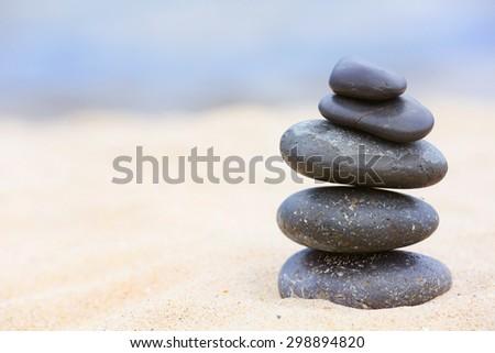 Zen stones balance spa on beach - stock photo
