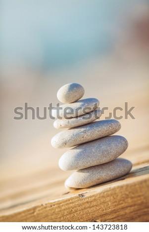 zen stones jy wooden banch on the beach near sea. Outdoor - stock photo