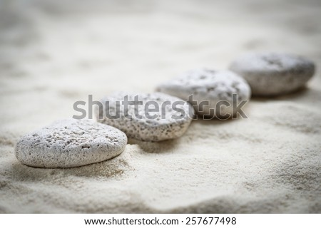 zen stones on the sand background - stock photo