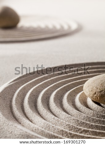 zen wellbeing and wellness with smoothness curves in sand - stock photo
