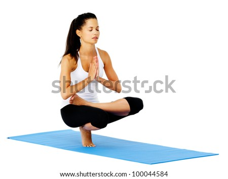 Zen yoga woman in mountain pose relaxed and calm. This is part of a series of various yoga poses by this model, isolated on white - stock photo