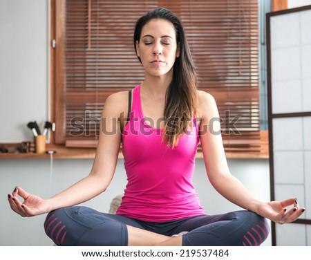 zen young woman meditating - stock photo