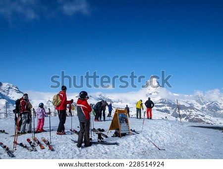 ZERMATT APR 15: Tourists prepare for playing ski near the Matterhorn on April 15, 2011 in Zermatt, Switzerland. The Matterhorn is  one of the highest peaks in the Alps with 4,478 metres high. - stock photo