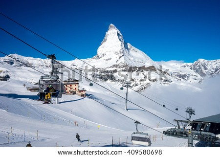 Zermatt, Switzerland- April 14,2016 : unidentified ski players in ski lift with Matterhorn Peak background - stock photo
