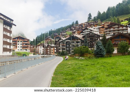 ZERMATT, SWITZERLAND - AUGUST 12: View of Zermatt in Switzerland on August 12, 2014. Zermatt is the car free famous ski resort town in the Swiss Alps at the base of the Matterhorn. - stock photo