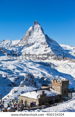 Zermatt, Switzerland - December 31, 2014 -Tourists at the Gornergrat train station with clear view to  Matterhorn. It is a starting point of the ski slope. - stock photo