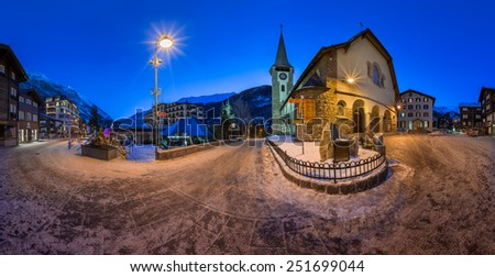 ZERMATT, SWITZERLAND - JANUARY 5: Panorama of Zermatt in Switzerland on January 5, 2015. Zermatt is the car free famous ski resort town in the Swiss Alps at the base of the Matterhorn. - stock photo