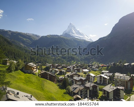 ZERMATT, SWITZERLAND-JUN 27: Valley of Zermatt and Mt.Matterhorn on Jun 27, 2011 in Zermatt, Switzerland. Zermatt is famed as a mountaineering and ski resort of the Swiss Alps. - stock photo