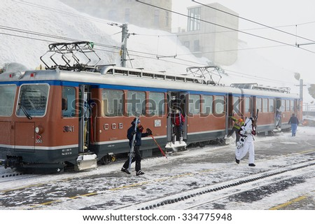 ZERMATT, SWITZERLAND - MARCH 04, 2009: Unidentified people disembark from the train at the upper Gornergratbahn railway station in Zermatt, Switzerland. - stock photo