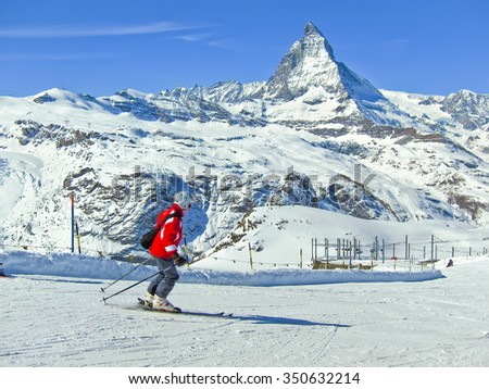 Zermatt, Switzerland - March 22, 2011: View of Matterhorn with some skiers skiing from Gornergrat, Zermatt, Switzerland on March 22, 2011. - stock photo
