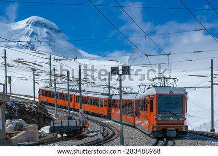 Zermatt,Switzerland -May 24. 2015: Red train climbing up to Gornergrat station on Zermatt, Switzerland. The Gornergrat rack railway is the highest open-air railway in Europe. - stock photo
