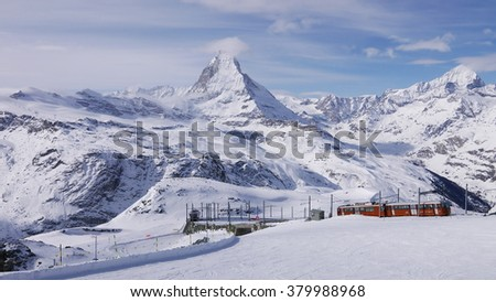 Zermatt, Switzerland -The train of Gonergratbahn running to the Gornergrat station in the famous touristic place with clear view to Matterhorn.