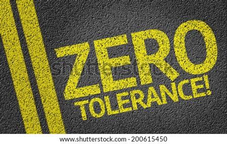 Zero Tolerance written on the road - stock photo