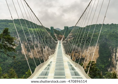 Zhangjiajie grand canyon, Hunan, China - August 4, 2016 : The new glass bridge over the Zhangjiajie grand canyon