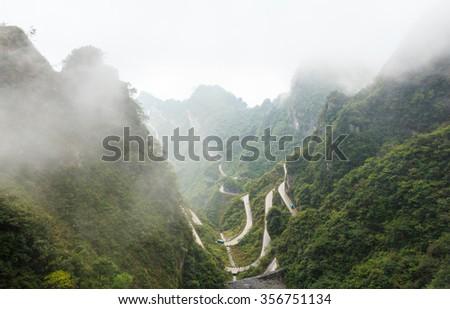 Zhangjiajie national park ( tian zhi shan ) ( Tianzi Mountain Nature Reserve ) and fog , China - stock photo