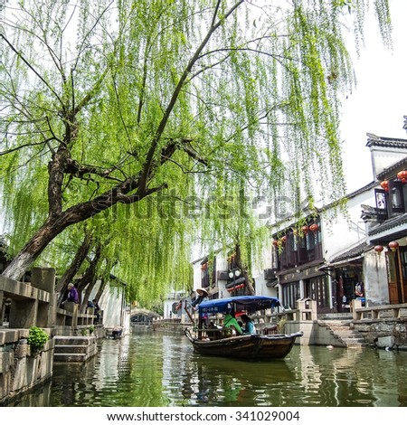 ZHOUZHUANG, SHANGHAI - April 11, 2011 : Zhouzhuang, the ancient water village is Shanghai tourist attraction with 1,000,000 visitors per year and there are a lot of variety activities have done here.