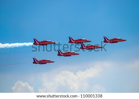 """ZHUKOVSKIY, RUSSIA - AUGUST 12: The Flight group of England """"Red arrows"""" at 100 - Years of the air forces of Russia August 12, 2012 in Zhukovskiy city, Russia - stock photo"""