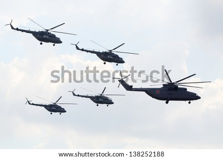 ZHUKOVSKY - AUGUST 12: Russian aerobatic team Berkuts on Mi-28 at airshow devoted to 100 anniversary of Russian Air Forces on August 12, 2012 in Zhukovsky, Moscow region, Russia. - stock photo