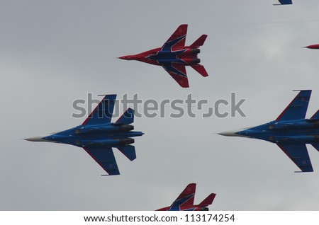 ZHUKOVSKY - 11 AUGUST 2012: Russian Knights Mig-29 and Su-27 shows demonstration flight at show dedicated to the centenary of the Russian Air Force 11 august, 2012 in Zhukovsky, Russia.