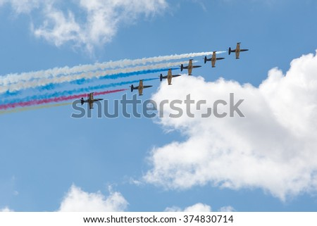 ZHUKOVSKY city, Moscow region, Russian Federation - August 30, 2015. MAKS 2015 - International Aviation and Space Salon. Planes flying in a row with multicolor vapor trail