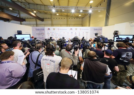 ZHUKOVSKY - JUNE 25: Photographers and journalists at press conference at second International Forum Engineering Technologies 2012, on June 25, 2012 in Zhukovsky near Moscow, Russia. - stock photo