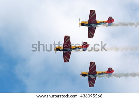 """ZHUKOVSKY, MOSCOW REGION, RUSSIA - AUG 29, 2015: A demonstration flight of the aerobatic team """"First flight"""" on Yakovlev Yak-52 plane at the International Aviation and Space salon MAKS-2015 - stock photo"""
