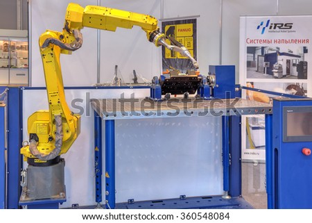 ZHUKOVSKY, MOSCOW REGION, RUSSIA - AUG 28, 2015: International Aviation and Space salon MAKS-2015. Robotic system for welding and spraying - multifunctional metalworking CNC machine - stock photo
