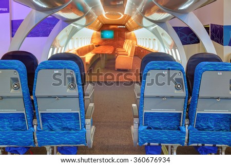ZHUKOVSKY, MOSCOW REGION, RUSSIA - AUG 30, 2015: International Aviation and Space salon MAKS-2015. Interactive Configurator layout of the cabin of the airliner Tupolev Tu-204 (Tu-214) - stock photo