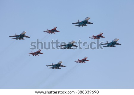 ZHUKOVSKY, MOSCOW REGION, RUSSIA - AUGUST 28, 2013: Aerobatic teams Swifts (Strizhi) on planes MiG-29 and Russian Knights on planes Su-27 at the International Aviation and Space salon MAKS-2013 - stock photo