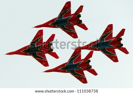 ZHUKOVSKY, MOSCOW REGION/RUSSIA - AUGUST 10: MiG-29 Fulcrum jet fighter aircrafts of Swifts aerobatic team. Airshow devoted to 100th anniversary of Russian Air Forces on August 10, 2012 in Zhukovsky. - stock photo