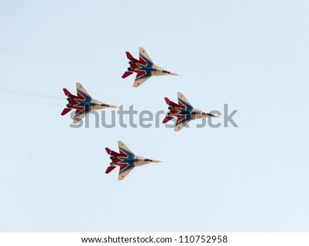 ZHUKOVSKY, MOSCOW REGION/RUSSIA - AUGUST 10: MiG-29 Fulcrum jet fighters of Swifts aerobatic team on airshow devoted to 100th anniversary of Russian Air Forces on August 10, 2012 in Zhukovsky. - stock photo