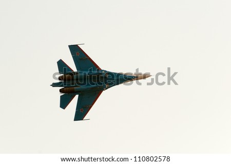 ZHUKOVSKY, MOSCOW REGION/RUSSIA - AUGUST 10: Su-27 Flanker of The Russian Knights aerobatic team. Airshow devoted to 100th anniversary of Russian Air Forces on August 10, 2012 in Zhukovsky. - stock photo