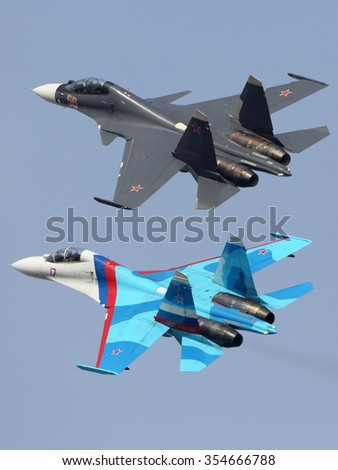 ZHUKOVSKY, MOSCOW REGION, RUSSIA - AUGUST 23, 2015: Sukhoi Su-30SM 56 RED an Su-27UB 17 RED of russian air force perfoming demonstration flight in Zhukovsky during MAKS-2015 airshow.