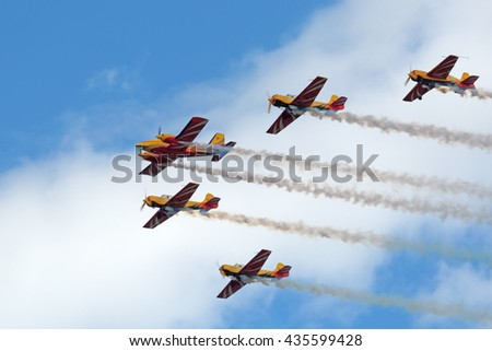 """ZHUKOVSKY, RUSSIA - AUG 29, 2015: A demonstration flight of the aerobatic team """"First flight"""" at the International Aviation and Space salon MAKS-2015. Aircraft Yakovlev Yak-52, Yak-54 and Piper PA-23 - stock photo"""