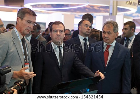 ZHUKOVSKY, RUSSIA - AUG 27: Boris Obnosov, Dmitry Medvedev and Sergey Shoygu at the International Aviation and Space salon MAKS. Aug, 27, 2013 at Zhukovsky, Russia