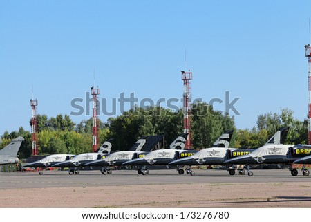 ZHUKOVSKY, RUSSIA - AUG 28, 2013: Breitling Jet Team is the civilian aerobatic display team in Europe at the International Aviation and Space salon MAKS-2013. Parking aircraft Ramenskoye airfield - stock photo