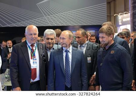 ZHUKOVSKY, RUSSIA - AUG 25, 2015: The CEO of Rostec Corporation Sergey Chemezov, President Vladimir Putin and head of Chechnya Ramzan Kadyrov at the International Aviation and Space salon MAKS-2015 - stock photo