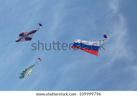 ZHUKOVSKY, RUSSIA - AUG 11: The opening ceremony of celebrating of the 100 anniversary of Russian air force of Russia. August, 11, 2012 at Zhukovsky, Russia. The paratroopers with flags in the sky
