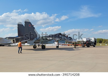 ZHUKOVSKY, RUSSIA - AUG 23, 2015: Towing aircraft Sukhoi Su-30 SM (Flanker-C) is two-seat, twin-engine supermaneuverable multirole fighter at the International Aviation and Space salon MAKS-2015