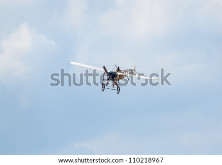 ZHUKOVSKY, RUSSIA - AUGUST 12: a replica of Bleriot XI vintage airplane flies during the celebration of the centenary of Russian Air Force on August 12, 2012 in Zhukovsky, Russia