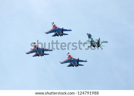 ZHUKOVSKY, RUSSIA - AUGUST 19: Aerobatic team Russian Knights at the International Aviation and Space salon (MAKS) on August 19, 2011 in Zhukovsky, Russia - stock photo