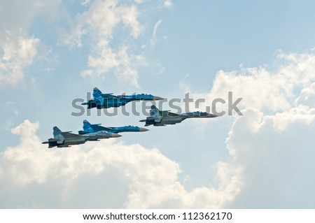 ZHUKOVSKY, RUSSIA - AUGUST 12: four Su-27 fighter jets fly in formation during the celebration of the centenary of Russian Air Force on August 12, 2012 in Zhukovsky, Russia
