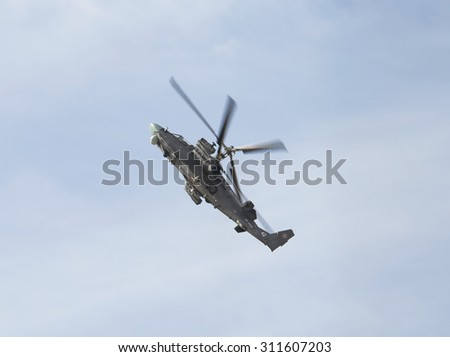 ZHUKOVSKY, RUSSIA - AUGUST 28, 2015: International aviation and space salon in Zhukovsky. The flight of the helicopter Ka-52 Alligator of military-air forces of Russia