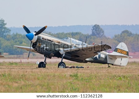 ZHUKOVSKY, RUSSIA - AUGUST 12: P-40 Kittyhawk historic fighter plane stand on the flight lane during the celebration of the centenary of Russian Air Force on August 12, 2012 in Zhukovsky, Russia