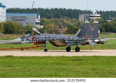 Zhukovsky, Russia - August 29: Sukhoi Su-35S with thrust vectoring system taxiing on runway after landing at the International Aviation and Space salon MAKS-2013.