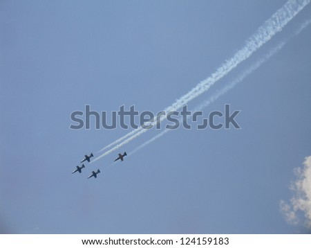 ZHUKOVSKY, RUSSIA - AUGUST 12: The Russian aerobatic team on military fighters L-39 with smoke in sky at International Airshow 100 years the Russian Air Force on August 12, 2012 in Zhukovsky, Russia